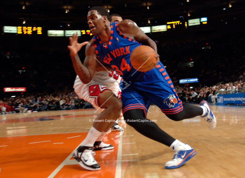 New York's Eddy Curry drives toward the basket during the 1st quarter of the New York Knicks vs Chicago Bulls match-up at Madison Square Garden Friday March 3, 2006. Robert Caplin For The New York Times..