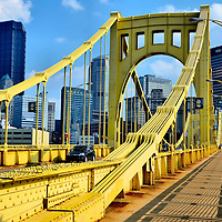 Andy Warhol Bridge and Downtown Pittsburgh Skyline in Pittsburgh, Pennsylvania <br /> The Seventh Street Bridge was built in 1926. It is one of the &ldquo;The Three Sisters&rdquo; suspension bridges crossing the Allegheny River from the North Shore to downtown Pittsburgh. This yellow span is now called the Andy Warhol Bridge. This pays tribute to the city&rsquo;s native son and pop art icon. Nearby is the Andy Warhol Museum. This bridge is just one of over 440 connecting the city of Pittsburgh. This is why its nickname &ldquo;The City of Bridges&rdquo; is well deserved.