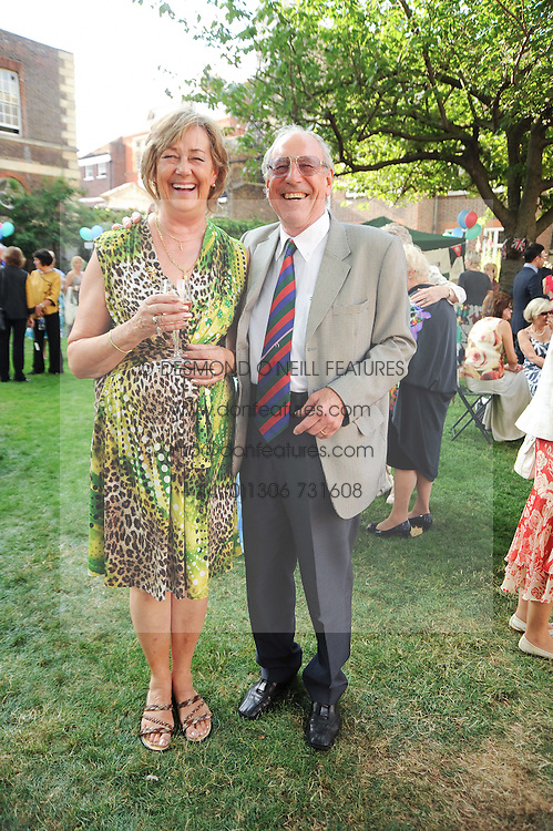 PETER & JOYCE HAMMOND at the Lord's Taverners Diamond Jubilee Garden Party held in College Gardens, Westminster Abbey, London on 8th July 2010.