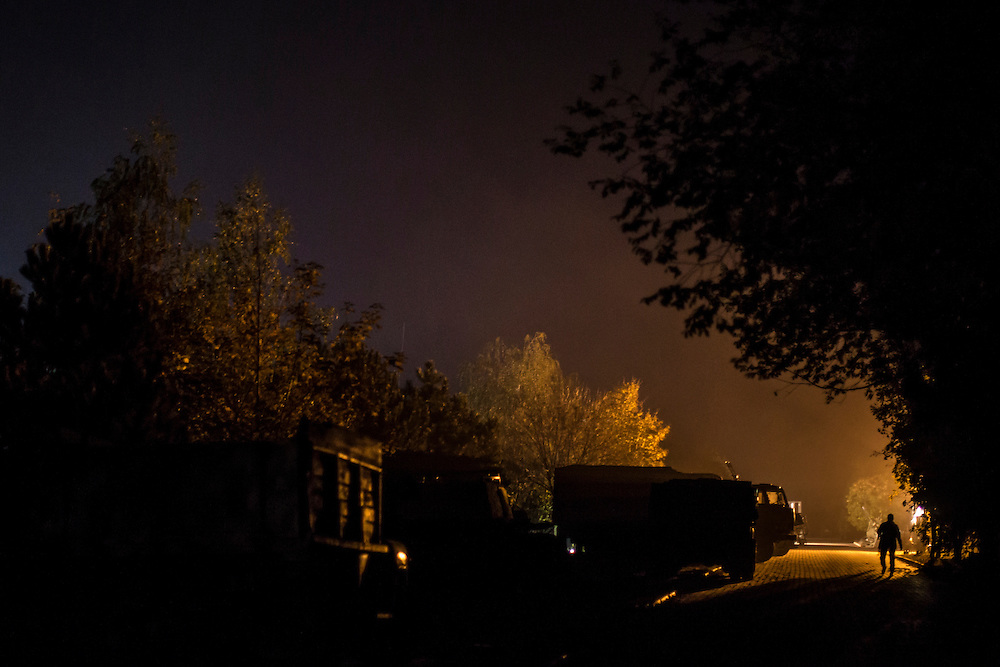 The base of the Azov Battalion, a pro-Ukraine militia, at dark on Wednesday, October 15, 2014 in Urzuf, Ukraine. Photo by Brendan Hoffman, Freelance