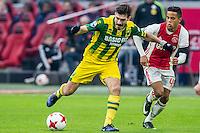 AMSTERDAM - Ajax - ADO , Voetbal , Eredivisie , Seizoen 2016/2017 , Amsterdam ArenA , 29-01-2017 ,  ADO Den Haag speler Edouard Duplan (l) in duel met Ajax speler Justin Kluivert (r)