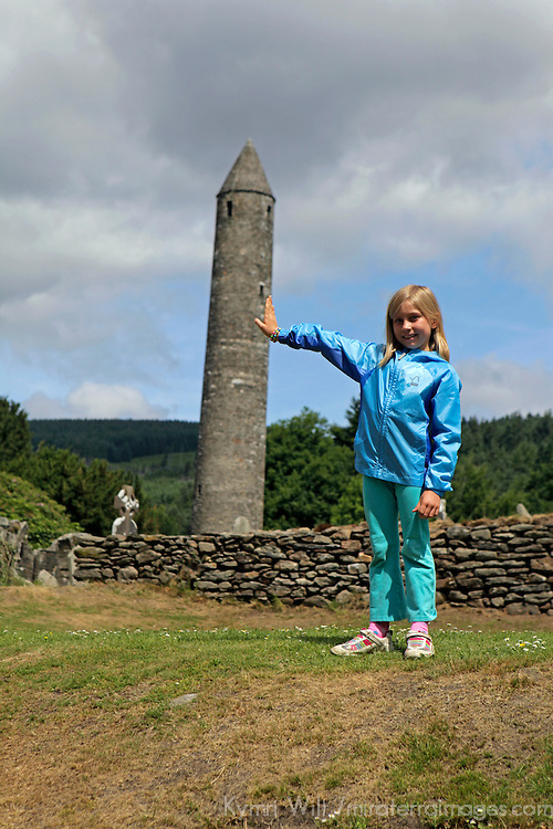 Europe, Ireland, Glendalough. Young girl at Monastic site of St. Kevin in Glendalough.