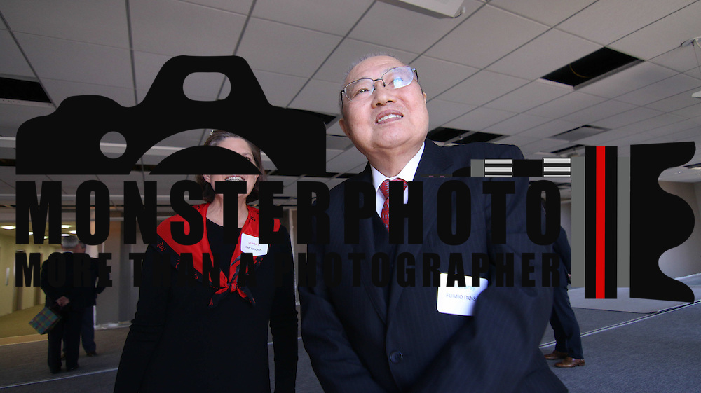 Kuraray President Fumio Ito (RIGHT) and duPont Ann Hriciga seen looking toward the Philadelphia skyline during Kuraray welcome ceremony Tuesday, Nov 18, 2014 at Kuraray in Wilmington, Del.