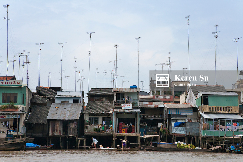Resident boats with antennae on Mekong River, Mekong Delta.