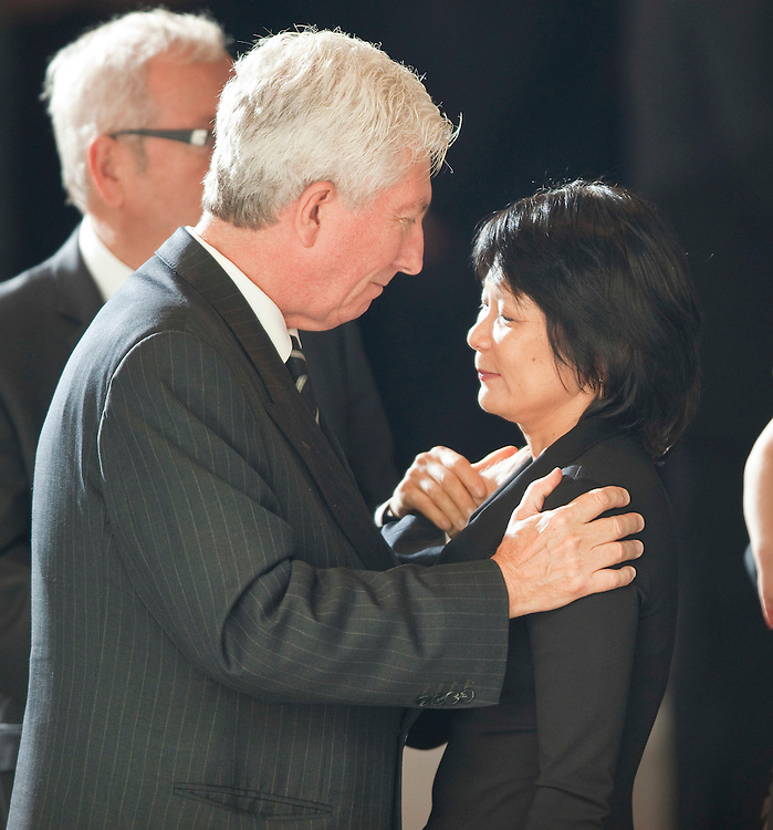 Toronto, Ontario ---11-08-27--- Gilles Duceppe, former leader of the Bloc Quebecois, speaks with Olivia Chow, Jack Layton widow following the state funeral for the NDP leader at Roy Thompson Hall in Toronto, Ontario, August 27, 2011. <br /> AFP/GEOFF ROBINS/STR