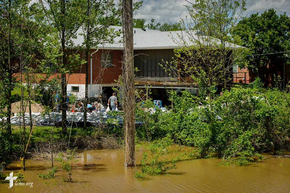 Volunteers from St. John's Lutheran Church, Arnold, Mo.,  fill sandbags to protect church member Ruth Houser's home from rising flood waters on Tuesday, May 2, 2017, in Arnold. LCMS Communications/Erik M. Lunsford