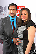 December 12, 2012-New York, NY- (L-R) Celebrity Photographer Johnny Nunez (Honoree) and Angelique Nunez attend the 2012 MirrorMirror Awards sponsored by Colgate & presented by Rollingout.com held at the Union Square Ballroom on December 12, 2012 in New York City. Rolling Out is the information source for urban lifestyle with national & local breaking news & original stories.(Terrence Jennings)