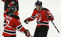 Apr 15, 2009; Newark, NJ, USA; New Jersey Devils defenseman Paul Martin (7) celebrates a goal by New Jersey Devils left wing Zach Parise (9) during the second period of game one of the eastern conference quarterfinals of the 2009 Stanley Cup playoffs at the Prudential Center.