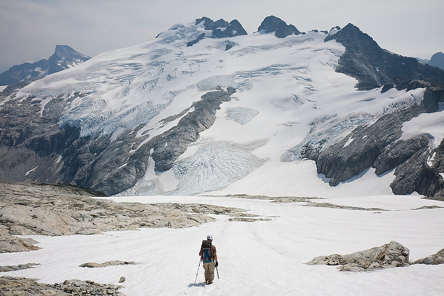 Jim Prager approaches Mount Challenger and the Challenger Glacier from Perfect Pass, Picket Range, North Cascades National Park, Washington.