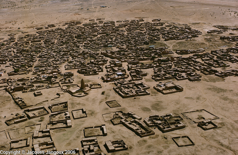Aerial view of Agadez, a Tuareg city in the Sahara desert in Niger, Africa. Tower at center left is mosque.
