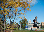Students running by campus. St. Aloysius Church and the Gonzaga soccer field behind.