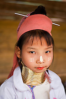 Young girl from the Padaung long neck hill tribe with traditional face markings, Tha Ton, Chiang Mai Province, Thailand