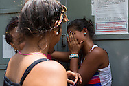 2016/05/26 - Caracas, Venezuela: Iris Silva, 20, cries in despair after being unable to buy butter at Mini Central Madeirense Super Market in La Urbina neighbourhood in Caracas. She was waiting since early hours in the morning to buy a few products. (Eduardo Leal)