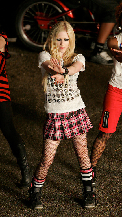 """June 01, 2007 Los Angeles, CA. Avril Lavigne films a music video for a remix of her song """"Girlfriend"""" with Lil' Mama. Avril was visited on set by her husband Deryck Whibley. Non Exclusive Photo By Eric Ford 1-818-613-3955 info@onlocationnews.com"""