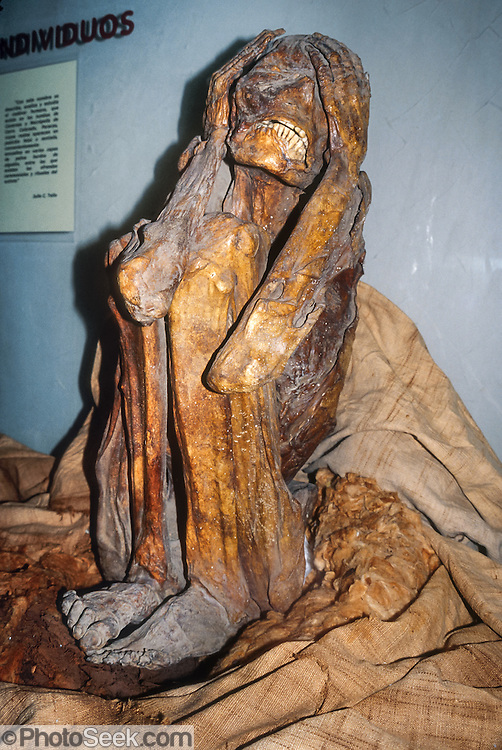 "An ancient mummy seems to cringe in sorrow or intense feeling at the Museo Nacional de Antropologia y Arqueologia (National Anthropology and Archeology Museum), Lima, Peru, South America. Its attitude of hands clutching head resembles Edvard Munch's ""The Scream,"" one of the most recognizable images in art history. UNESCO honored the Historic Centre of Lima on the World Heritage List in 1988 and 1991."