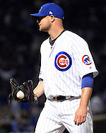 CHICAGO, IL - OCTOBER 7:  Jon Lester #34 of the Chicago Cubs reacts after recording the third out of the sixth inning after the baseball hit by Buster Posey #28 of the San Francisco Giants got stuck in the webbing of his glove during Game 1 of NLDS at Wrigley Field on Friday, October 7, 2016 in Chicago, Illinois. (Photo by Ron Vesely/MLB Photos via Getty Images) *** Local Caption *** Jon Lester; Buster Posey