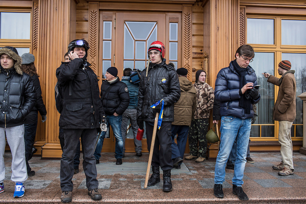 KIEV, UKRAINE - FEBRUARY 22: Anti-government protesters guard the entrace to a house on President Viktor Yanukovych's Mezhyhirya estate, which was abandoned by security, on February 22, 2014 in Kiev, Ukraine. After a chaotic and violent week, protesters took control of Kiev as President Viktor Yanukovych fled the city amid calls for his immediate resignation. (Photo by Brendan Hoffman/Getty Images) *** Local Caption ***