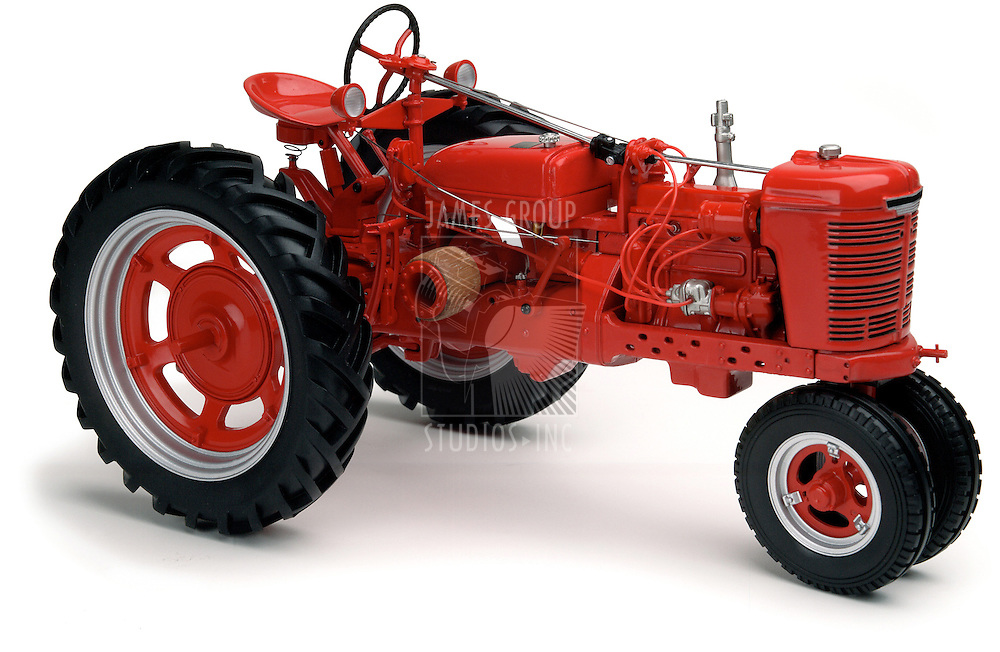 vintage red Farmall tractor on white background