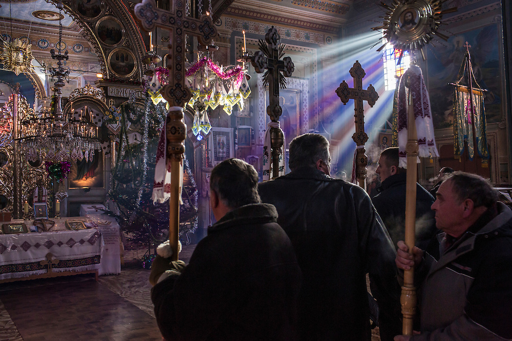 ILTSI, UKRAINE - JANUARY 7: Villagers gather at Holy Trinity Church to celebrate the Orthodox Christmas on January 7, 2015 in Iltsi, Ukraine. While many of the traditions are similar across Ukraine, the customs of the Hutsul culture are common in the Carpathian Mountains. (Photo by Brendan Hoffman/Getty Images) *** Local Caption ***
