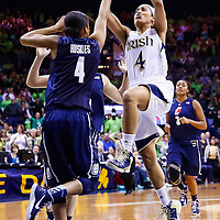 SOUTH BEND, IN - MARCH 04: Skylar Diggins #4 of the Notre Dame Fighting Irish shoots the ball Moriah Jefferson #4 of the Connecticut Huskies at Purcel Pavilion on March 4, 2013 in South Bend, Indiana. Notre Dame defeated Connecticut 96-87 in triple overtime to win the Big East regular season title. (Photo by Michael Hickey/Getty Images) *** Local Caption *** Skylar Diggins; Moriah Jefferson
