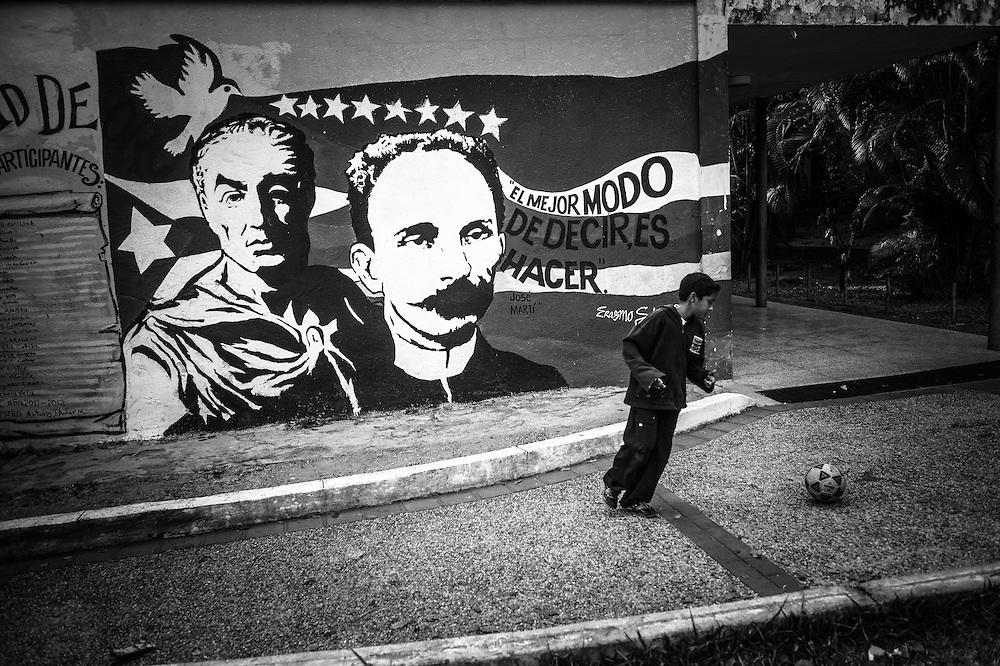 Paintings of revolutionaries, Simon Bolivar and Jose Marti on the walls of the Sarria nucleo, of the El Sistema music program in a dangerous slum in Caracas, Venezuela.