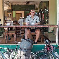 Bike tourist in a road side cafe, Cost Rica