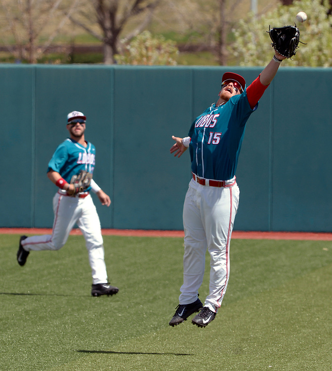 gbs032217q/SPORTS -- A Grand Canyon fly ball travels over the glove of UNM's Jared Mang, 15, in the first inning of the game at the Santa Ana Star Field on Wednesday, March 22, 2016. (Greg Sorber/Albuquerque Journal)
