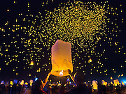 Participants inflate more lanterns and release them to the already speckled sky during the RiSE Lantern Festival at the Jean Dry Lake Bed.