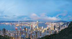 Dusk skyline of Hong Kong and Victoria Harbour from The Peak on a clear day