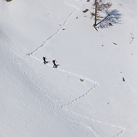 Two hikers in snow shoes explore the Italian Alps in Gran Paradiso