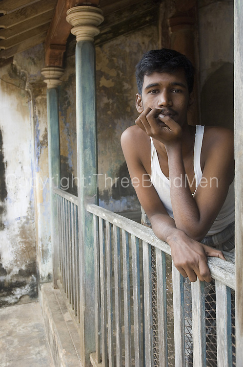 Man looking out from veranda of his village home near Nagapattinam in Tamil Nadu.