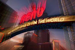 """Downtown Reno 4"" - This Reno, The Biggest Little City in the World sign was photographed in Reno, Nevada at sunset. The effect was obtained in camera by long exposure mixed with intentional camera movement."