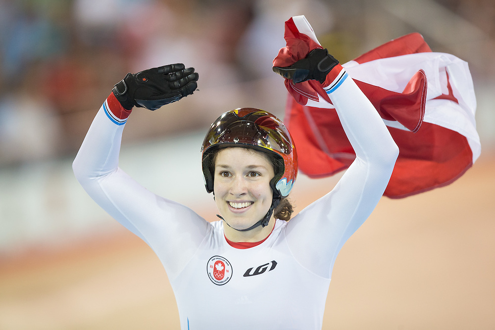 Monique  Sullivan of Canada celebrates her gold medal win in the women's cycling sprint finals at the 2015 Pan American Games in Toronto, Canada, July 19,  2015.  AFP PHOTO/GEOFF ROBINS