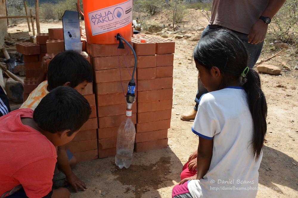 Distributing Sawyer water filters in Torrecillo, Santa Cruz, Bolivia