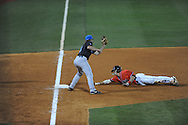 Ole Miss' Andrew Mistone (25) hits a three-run triple vs. Kentucky's Max Kuhn (9) at Oxford-University Stadium in Oxford, Miss. on Friday, April 26, 2013. Ole Miss won 11-5.