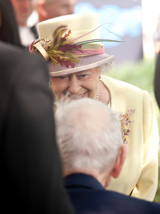Queen Elizabeth II speaks with veterans outside of Research in Motion following a tour of the company's facilities in Waterloo, Ontario, July 5, 2010.<br /> AFP/GEOFF ROBINS/STR