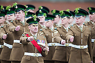 Soldiers from the 1st Battalion the Irish Gurads march past the Duke and Duchess of Cambridge who attended their annual St Patrick's Day Parade at Mons Barracks, Aldershot, Hampshire.<br /> Picture date Monday 17th March, 2014.<br /> Picture by Christopher Ison. Contact +447544 044177 chrisison@mac.com