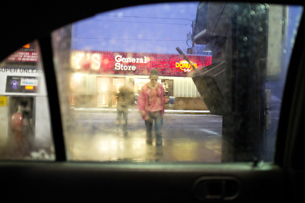 Penny walks back to her car at the gas station on Saturday, December 3, 2011 in Webster City, IA.