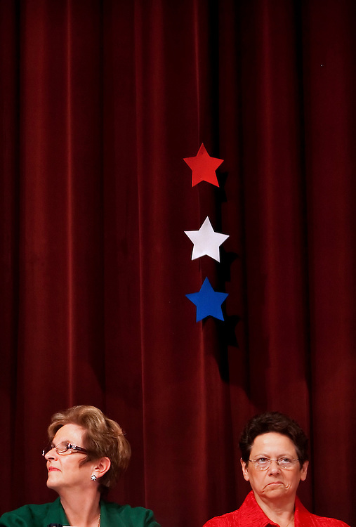 ORLANDO, FL -- October 21, 2010 -- Florida Tea Party candidates Peg Dunmire, left, and Nina Virone listen in during a debate at Jones High School in Orlando, Fla., on Thursday, October 21, 2010.