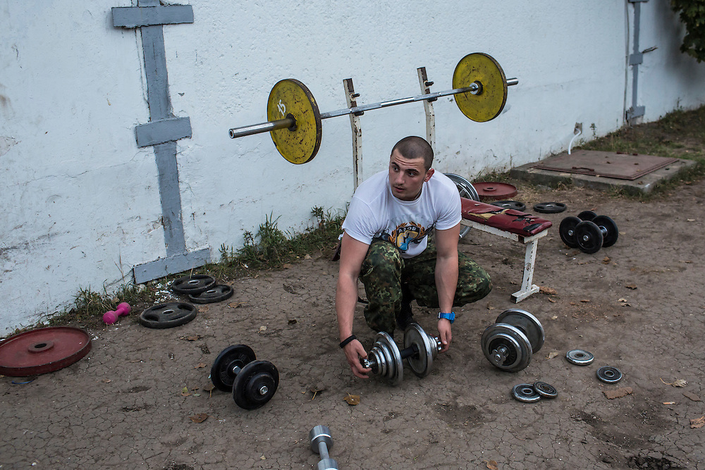A man exercises at the base of the Azov Battalion, a pro-Ukraine militia, on Wednesday, October 15, 2014 in Urzuf, Ukraine. Photo by Brendan Hoffman, Freelance
