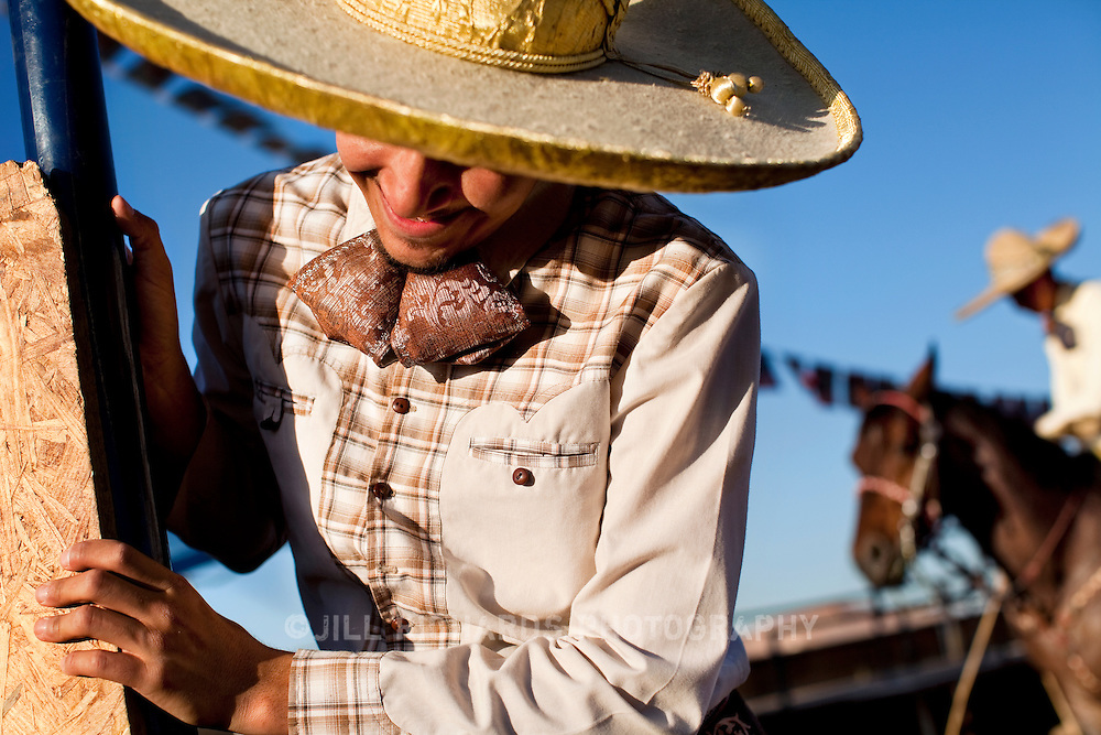 040513 Phoenix, AZ--- A traditional Mexican charro closes a gate to the arena at Rancho Ochoa in south Phoenix, AZ on Friday April 5, 2013. The charros compete in charreada, a Mexican-style rodeo that shows off roping and riding skills.<br />
