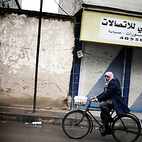 SYRIA - Al Qsair. A man rides a bicicle in Al Qsair, on January 24, 2012. Al Qsair is a small town of 40000 inhabitants, located 25Km south-west of Homs. The town is besieged since the beginning of November and so far it counts 65 dead. ALESSIO ROMENZI