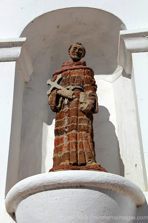 USA, California, Oceanside. Brick statue of saint at Old Mission San Luis Rey de Francia.