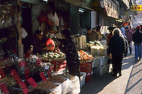 A market stall & people in Tai Po market, Hong Kong, China.