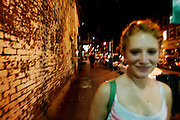 Melissa walks along West State St. in Athens, Ohio on May 30, 2006.
