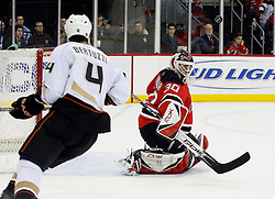 February 8, 2008; Newark, NJ, USA;  The puck pops in the air after a blocker save by New Jersey Devils goalie Martin Brodeur (30) during the third period at the Prudential Center in Newark, NJ. The Anaheim Ducks defeated the New Jersey Devils by a 2-1 margin.