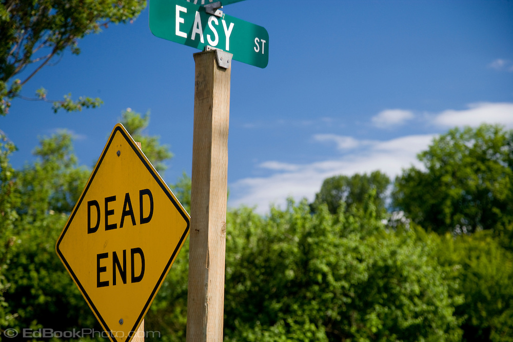 Street signs announce Dead End on Easy Street, Brinnon, Washington, USA