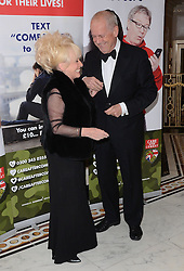 Barbara Windsorand Gyles Brandreth attend The Care After Combat Inaugural Ball at The Dorchester Hotel, Park Lane, London on the Tuesday 31st March 2015