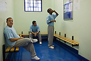 Prisoners in the wiating room for new arrivals on E wing. HMP Wandsworth, London, United Kingdom