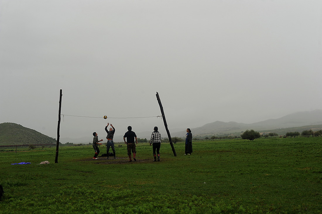 A group of herders get together after their afternoon milking for a game of volleyball. — © Jeremy Lock/USAF